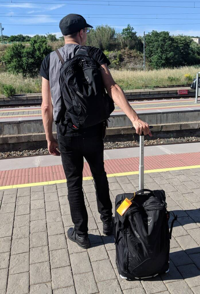 a5b3051e73c7 Rolling the Osprey Ozone Convertible 50L   22in while waiting for a train  in Spain with the daypack on my back. It s held up well for me for over a  year and ...